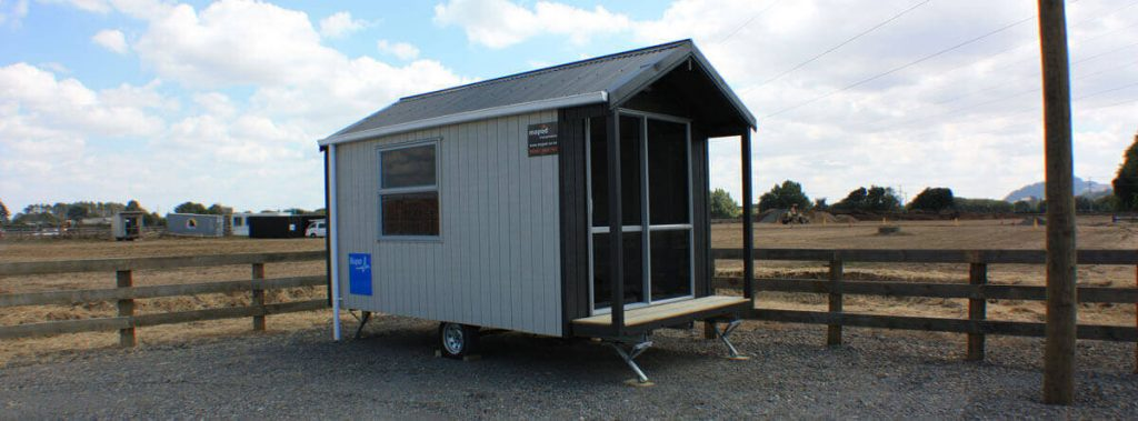 Affordable versatile portable cabins for sale in new zealand for Garden rooms on wheels